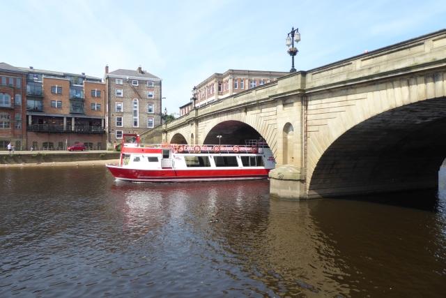 Boat passing under Ouse Bridge