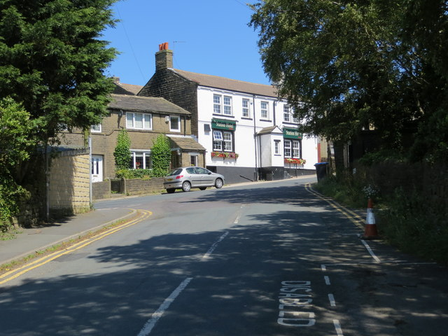 Station Road at its junction with Haworth Road (B6144) at Harecroft