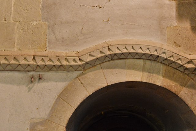 Stewkley, St. Michael's Church: String course, eight feet high, running round the church