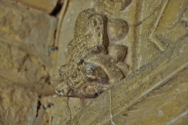 Stewkley, St. Michael's Church: Grotesque label stop, south door