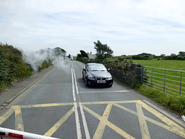 Car waiting at a level crossing