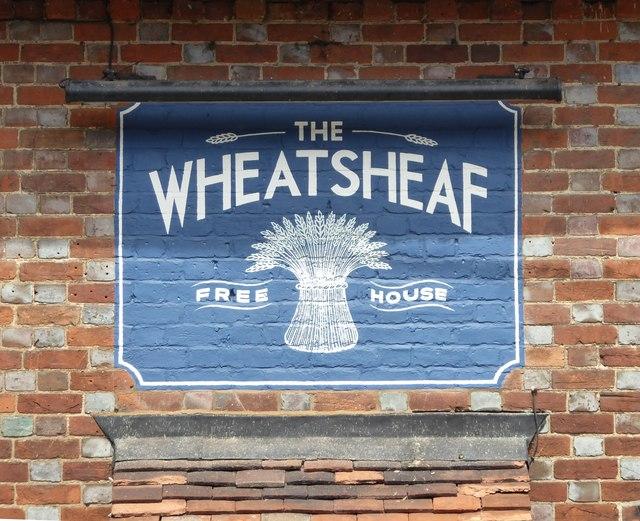 Pub sign and brickwork: The Wheatsheaf, Chilton Foliat