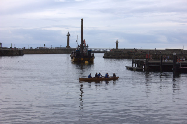 Whitby harbour, rowers and dredger