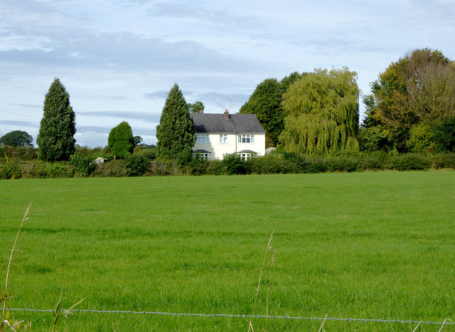 Pasture and cottage north of Marbury in Cheshire