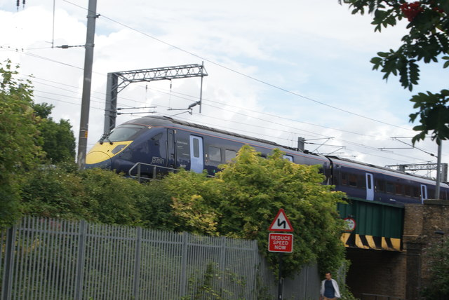 View of a Class 395 Javelin crossing the Camley Street bridge
