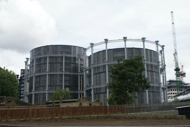 View of blocks of flats shaped like gasholders next to Somers Town Bridge from Camley Street