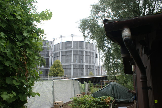 View of flats in the shape of a gasholder from Camley Street Nature Park