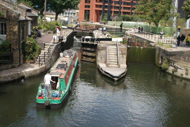 View of a second narrowboat entering St. Pancras Lock from Somers Town Bridge