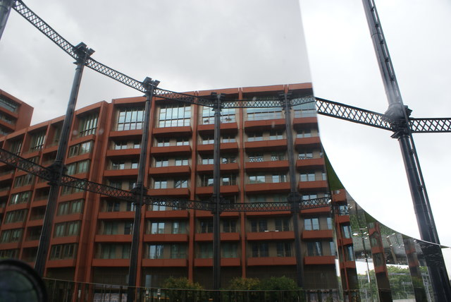 View of a reflection of Tapestry Apartments in one of the mirrors in Gasholder Park #2