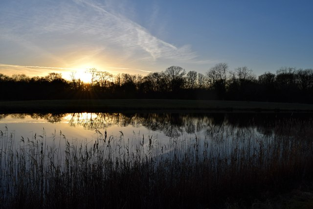 Sunset reflected: Pond west of Ash Grove