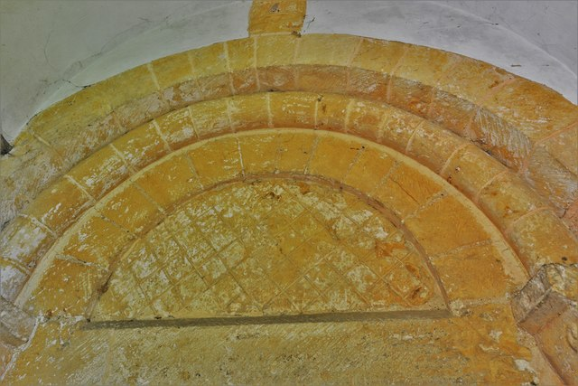 Saintbury, St. Nicholas' Church: Tympanum above the Norman south doorway