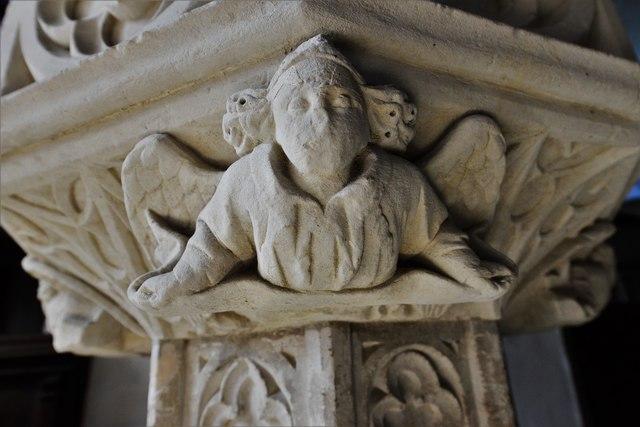 Wing, All Saints Church: Font bowl supporting angel 3