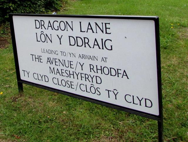 Large bilingual street name sign on a Govilon corner