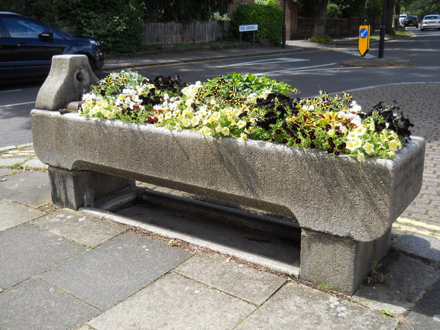 Old cattle trough with flowers on The Green, Winchmore Hill