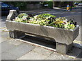 TQ3194 : Old cattle trough with flowers on The Green, Winchmore Hill by Paul Bryan