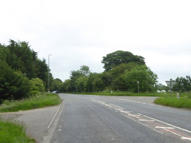 Staggered crossroads with A37 at Old Down