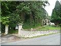 SO8707 : The gateway to Holy Trinity Church, Slad by Humphrey Bolton