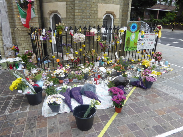 Flowers and candles outside Notting Hill Methodist Church