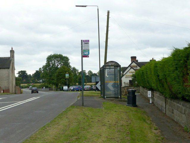 Morley Smithy, bus stop, milepost and pub