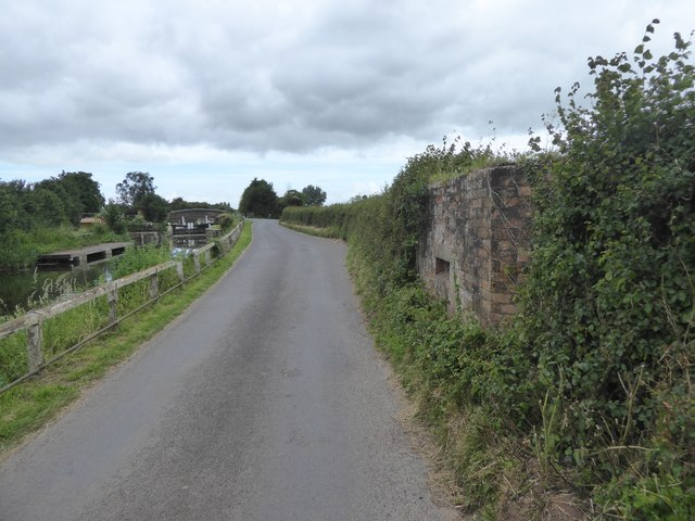 Pillbox by road near Higher Lock