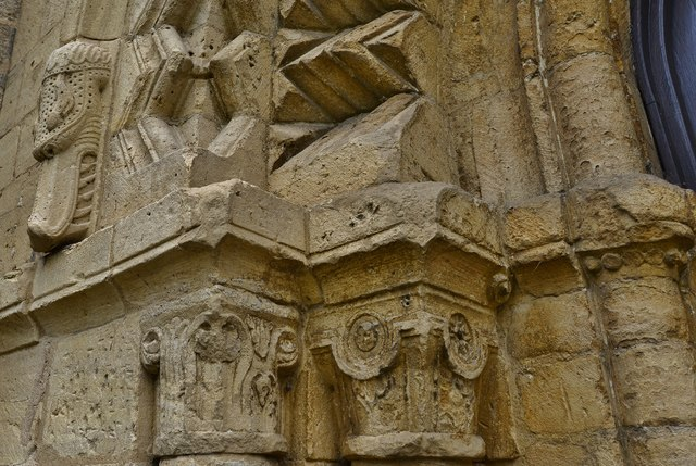 Bishops Cleeve, St. Michael and All Angels Church: Norman west doorway capitals and serpent with vicious teeth