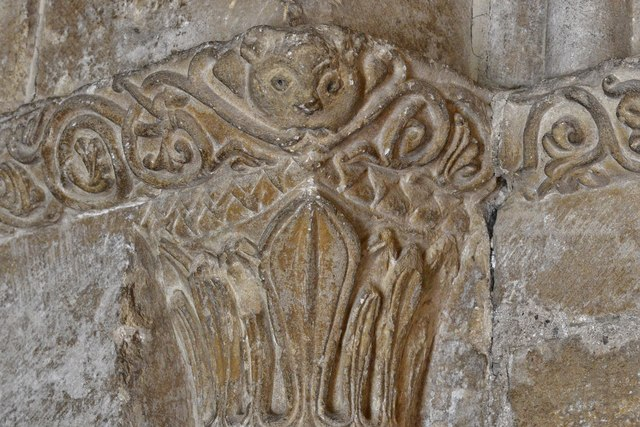 Bishops Cleeve, St. Michael and All Angels Church: Modest green man on the south porch doorway
