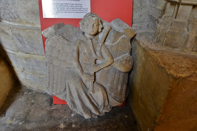 Tewkesbury Abbey: Saved sculpture of a medieval bagpiper