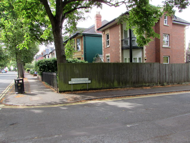 Wooden fence and metal railings on a Cheltenham corner