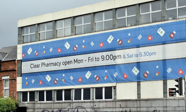 Pharmacy advertising, Belfast (July 2017)