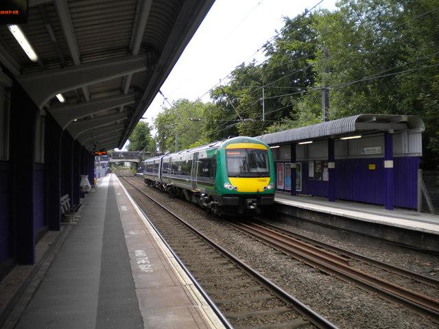 Train speeding through Bournville station