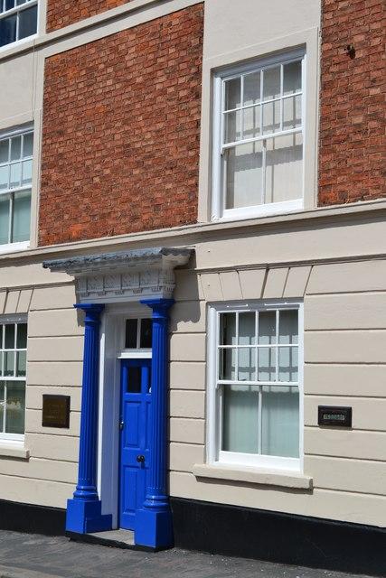 Blue door and white windows