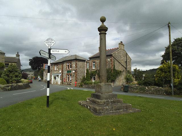 Austwick market cross and signpost