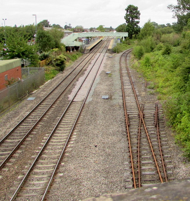 Rusty railway line past the east side of Ashchurch railway station