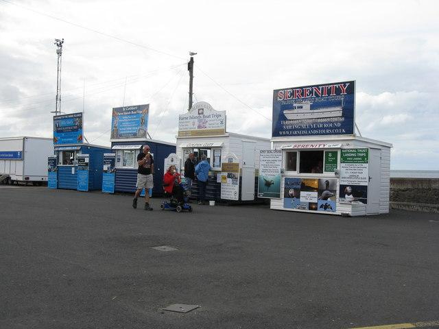 Boat trip kiosks at North Sunderland Harbour