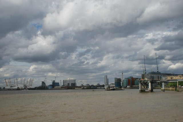 View of new flats, the O2 and the Emirates Air Line cable car from Greenwich Riverside