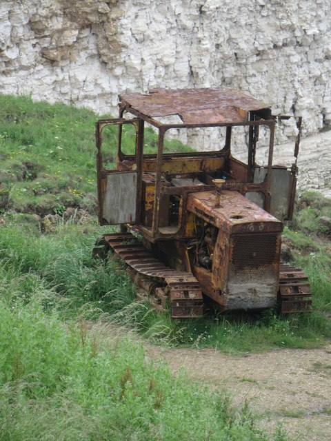 Rusting tractor, North Landing