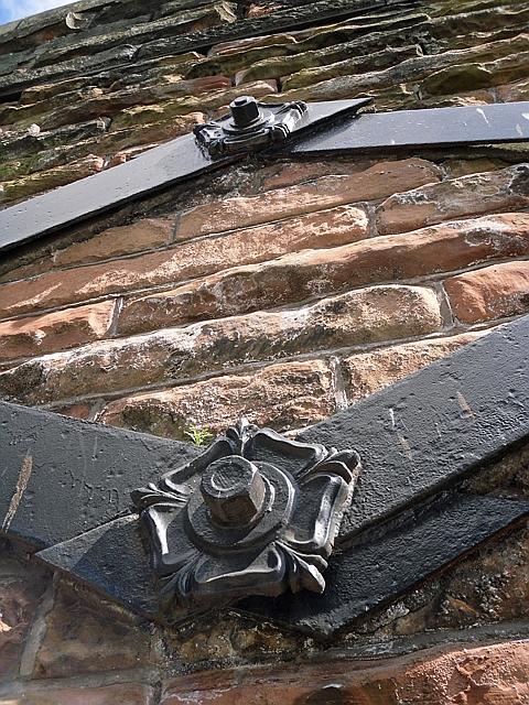 Decorative iron fixings on viaduct wall bracing