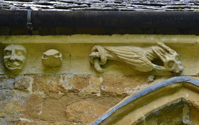 Hanwell, St. Peter's Church: South frieze, ca. 1340: Head and bizarre winged creature with knotted tail