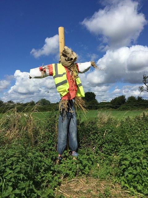 Scarecrow alongside the Severn