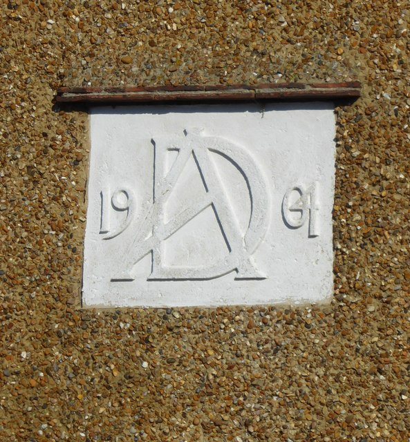Date plaque (1904) and monogram (AD) on a house in St Swithin's Road, Tankerton
