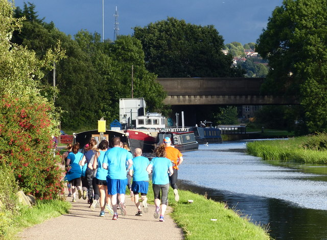 Runners on the towpath of the Leeds and Liverpool Canal