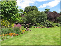 TQ2782 : The Holme, lawn and herbaceous borders by David Hawgood