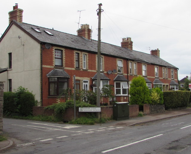 Row of brick houses and a telecoms cabinet, Hereford Road, Mardy