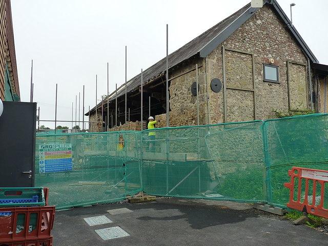 Repair work underway on old barn