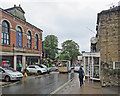 SK3447 : Belper: clock repairs on a wet afternoon by John Sutton