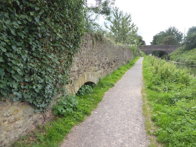 Partly buried arch in wall at Buckland Bridge