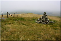 SD7695 : Cairn and fence on Swarth Fell Pike by Roger Templeman