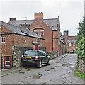 SK3447 : Belper: Cluster Road on a wet morning by John Sutton