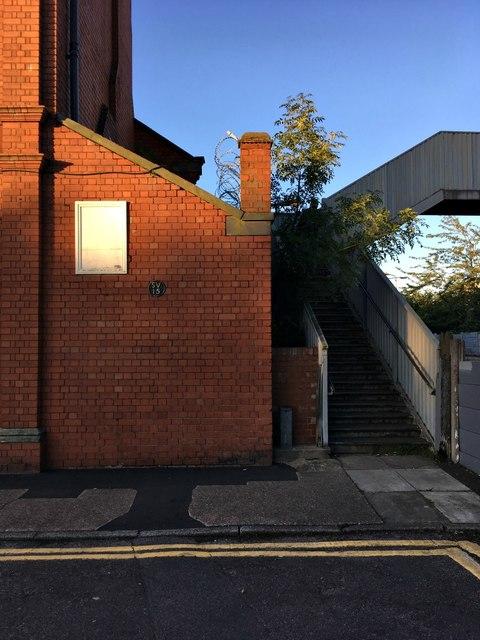 Pub off-shot and railway footbridge