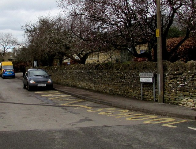 Zigzag yellow markings on School Road, Minchinhampton